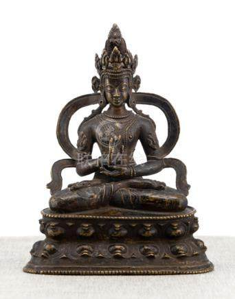 A BRONZE FIGURE OF AMOGHASIDDHI, TIBET, ca. 14th ct., seated in vajrasana on a lotus base with his r