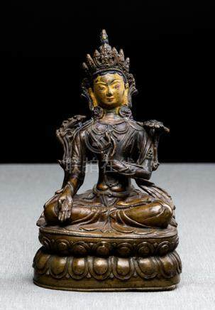 A BRONZE FIGURE OF SITATARA, TIBET, 16th/17th ct., seated in vajrasana on a lotus base with her righ