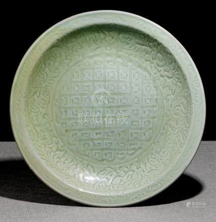 A LARGE CELADON CHARGER WITH LOTOS AND PEONIES, China, early Ming dynasty - Former property from an