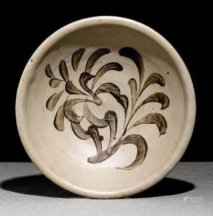 A CIZHOU BOWL WITH STYLISED LEAVES, China, Song/Yuan dynasty. - Property from an old North German pr