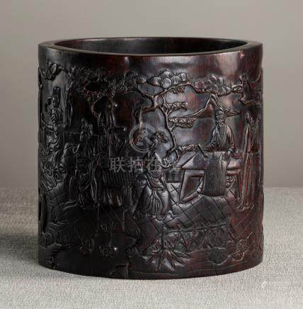 A WELL CARVED HARDWOOD BRUSHPOT WITH A SCHOLAR'S SCENE IN A GARDEN LANDSCAPE, China, Qing dynasty -