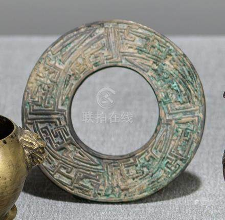 A BRONZE DISC WITH ABSTRACT DECOR, China, Eastern zhou dynasty - Property from an old Berlin private