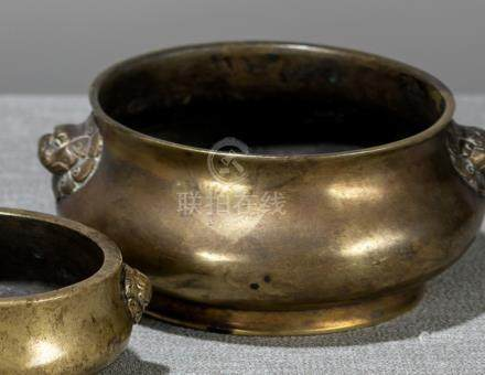 A BRONZE CENSER WITH MASK HANDLES, China, cast Xuande-six-character marks encircled by two dragons,