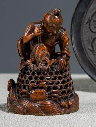A BAMBOO CARVING OF A FISHER MAN AND BASKET, China, Qing dynasty - Property from an old Berlin priva