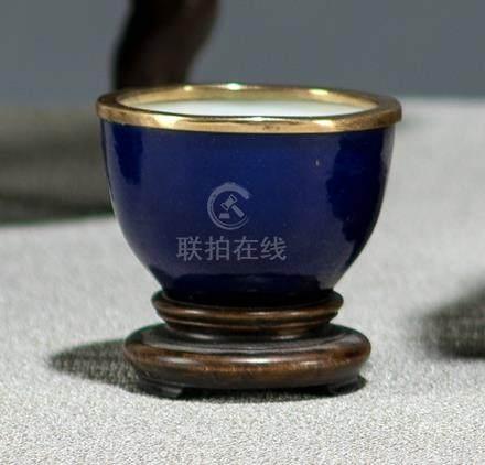 A MONOCHROME BLUE-GLAZED PORCELAIN WINE CUP WITH GILT METAL MOUNTs, China, Chenghua six-character ma
