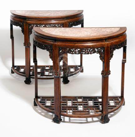 A PAIR OF HALF-ROUND CARVED HARDWOOD TABLES WITH STONE TOPS, China, Qing dynasty - Property from a R