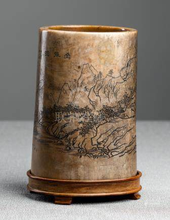A CARVED IVORY 'LANDSCAPE' BRUSH POT, China, Kangxi period, cyclically dated to 1674. Delicately car