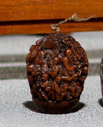 A FINE CARVED TWO-PART NUT WITH IMMORTALS, China, Qing dynasty - Property from an Austrian private c