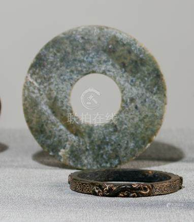 A JADE BI DISC AND CHILONG BANGLE, China - Property from a German private collection, assembled betw