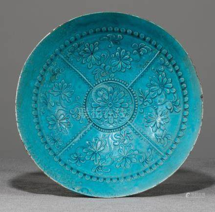 A LARGE TURQUOISE-GLAZED MOLDED POTTERY BOWL, China, Ming dynasty or earlier - Former property from