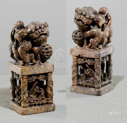 A PAIR OF LARGE SOAPSTONE SEALS IN THE SHAPE OF FO-LIONS ON PEDESTALS, China, late Qing dynasty - Pr