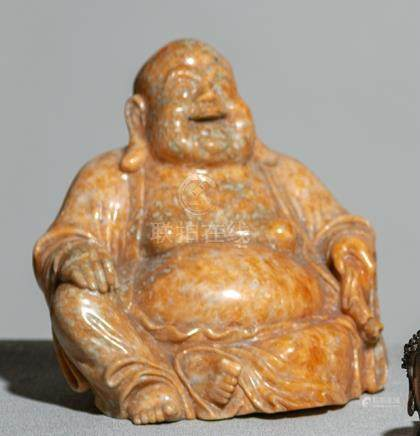AN ORANGE JASPER FIGURE OF LAUGHING BUDAI, China, late Qing dynast/Republic period. - Property from