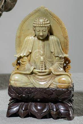 A SOAPSTONE CARVING OF BUDDHA HOLDING A PAGODA, China, late Qing dynasty - Property from a European