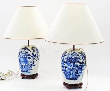 A pair of Chinese porcelain blue and white vases converted to table lamps on wooden bases. The