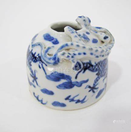 A Chinese blue and white porcelain brush washer with lizard in relief, bearing Ming Xuande