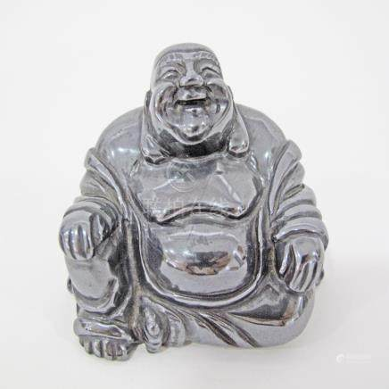A Chinese carved obsidian figure of a happy Buddha, H60mm.