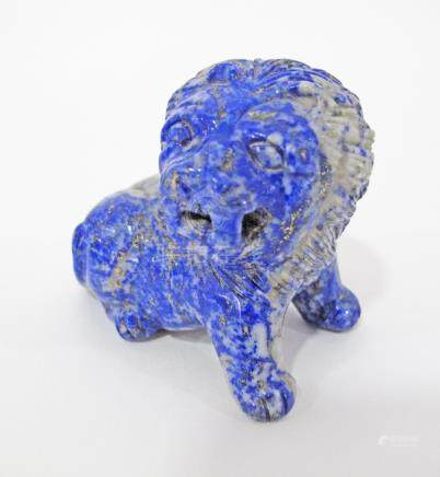 A Chinese carved lapis lazuli figure of a lion. H50mm.