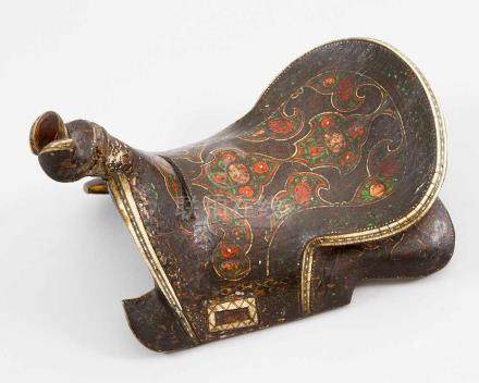 A Turkmenistan Saddle, wood carved in traditional shape, with one central hole for fixing, on the