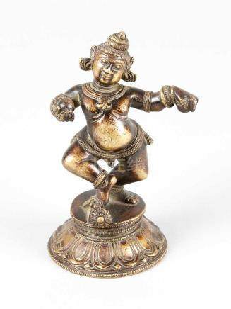 Krishna, in dancing position, on a round base with lotus leaves, bronze cast with fine hand-