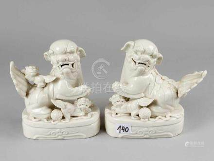Pair of Lions, blanc de chine, porcelain on oval bases, with a female and male lion, old pressure