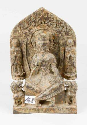 Indo-Chinese Goddess, in sitting position with blessing hand and crowned, on the sides two lions and