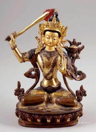 Bodhisattva ManjushriBronze, vergoldet. H. 20 cm. In seiner einen Hand hält er das flammende