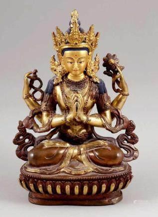 GuanyinChina 20. Jahrhundert. Bronze, teils goldfarben. H. 21 cm. Die Bodhisattva thront in