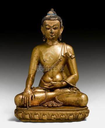 铜鎏金釋迦摩尼佛像。