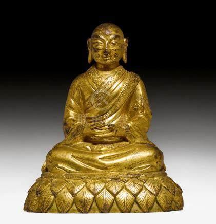 铜鎏金鑄僧人像。