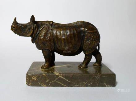 A Patinated Bronze Figure of Rhinoceros on marble stand.