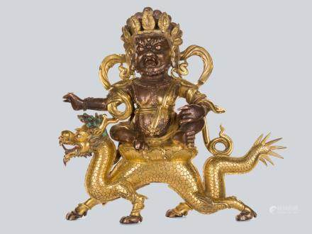 An Extremely Rare Gilt Bronze Figure of White Jambhala, China, 18th Century.
