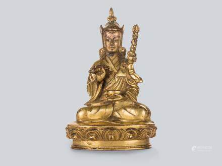 A Gilt Bronze Figure of Padmasambhava, Tibet 17th Century.