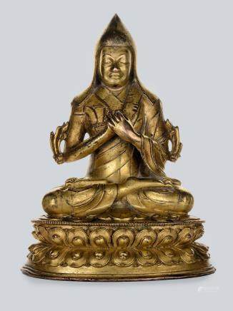 An inscribed Gilt Bronze Figure of Lama, Tibet, 18th Century or Earlier.