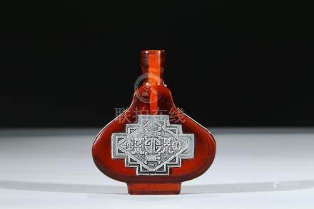 A RED GLASS SILVER INLAID SNUFF BOTTLE