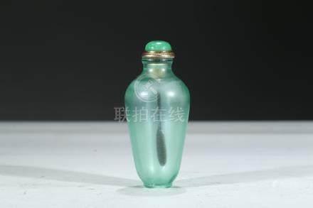A GREEN GLASS SNUFF BOTTLE