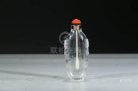 A ROCK CRYSTAL RELIEF-DECORATED SNUFF BOTTLE