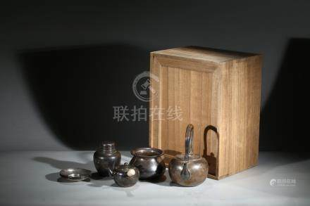 A SET OF FOUR TEAPOT AND VESSELS