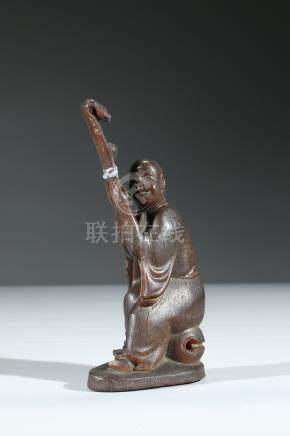 A CARVED HORN FIGURE OF MONK