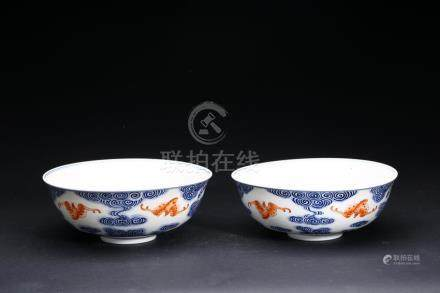 A PAIR OF BLUE AND WHITE 'BATS' BOWLS