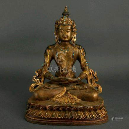 A RARE QING GEM INLAID GILDED BRONZE FIGURE OF BUDDHA