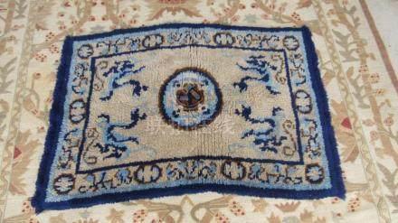 A Beuatiful Blue And Tan Rug