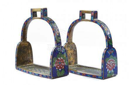 A pair of enameled stirrups
