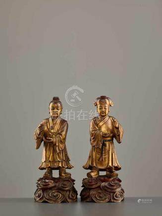 A PAIR OF WOOD AND LACQUER 'TWIN IMMORTALS OF HARMONY' FIGURES, 17th – 18th CENTURYEach carved