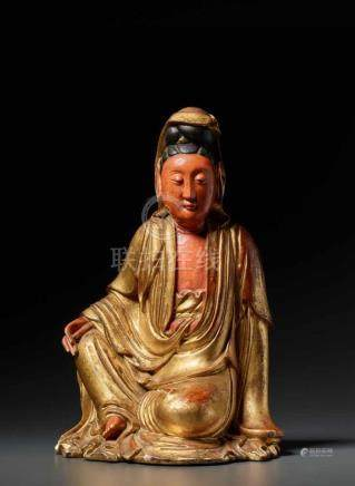 A RARE POLYCHROME CARVED WOOD FIGURE OF 'GUANYIN IN ROYAL EASE, KANGXICarved of one single piece