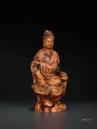 A CARVED QING DYNASTY BOXWOOD FIGURE OF GUANYIN Boxwood China, Qing Dynasty This masterly carved
