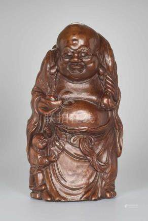 A VERY LARGE BAMBOO SHOOT CARVING OF BUDAI WITH INGOT, QING DYNASTYBamboo root China, Qing Dynasty