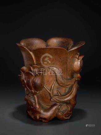 A CARVED KANGXI PERIOD BAMBOO 'MAGNOLIA' LIBATION CUP Bamboo, black lacquer China, Kangxi period (
