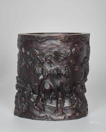 A LARGE ZITAN 'TREE TRUNK' BRUSHPOT WITH SCHOLARS, QING DYNASTY Carved Zitan wood, signed Wu Shi,