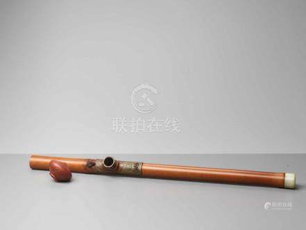 A BAMBOO, JADE AND YIXING OPIUM PIPE, QING DYNASTYThe pipe consisting of one single bamboo