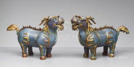TWO CLOISONNÉ ENAMEL QILIN, QING DYNASTY The bronze bodies with polychrome cloisonné enamels and